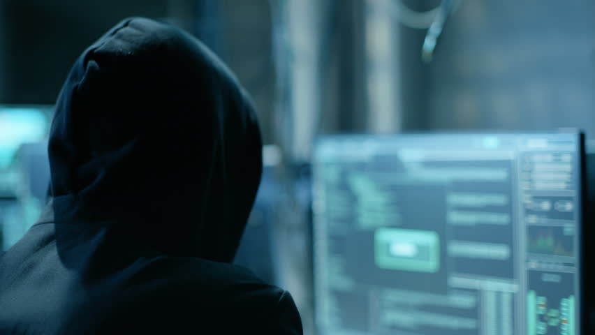 Masked Hacktivist Organizes malware Attack on Global Scale. They're in Underground Secret Location Surrounded by Displays and Cables. Shot on RED EPIC-W 8K Helium Cinema Camera. | Shutterstock HD Video #27247378