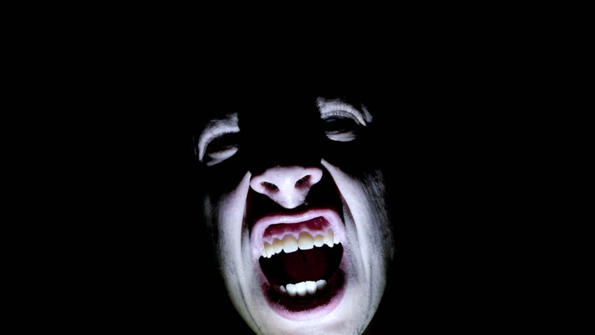 Horror scene screaming man face. Scary evil many faces. Devil spiritual exorcism. close up top view.