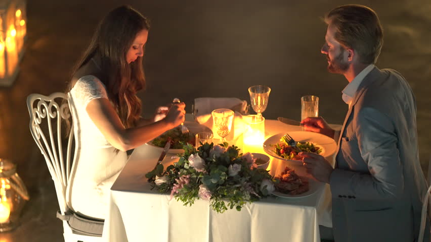 4k00:164k Footage, Honeymoon Couple Having Private Luxury Candle Light  Dinner Outside On Restaurant Terrace
