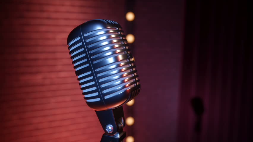 Vintage microphone on empty comedy club stage