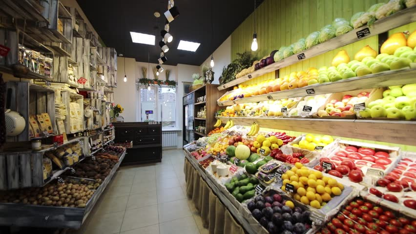 Turning light off and on in shop with vegetables, fruits, Text translation - Tomatoes, cucumbers, mix, cabbage, plump