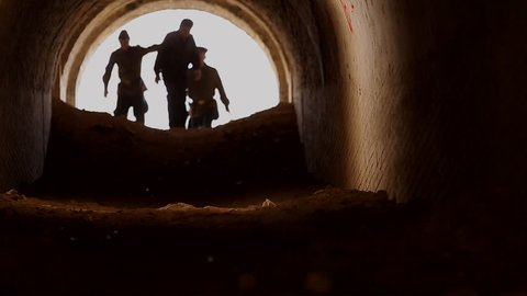 Agents kgb lead the prisoner into a cave for interrogation, three silhouettes, times of the USSR, interpret a person, aggressive people