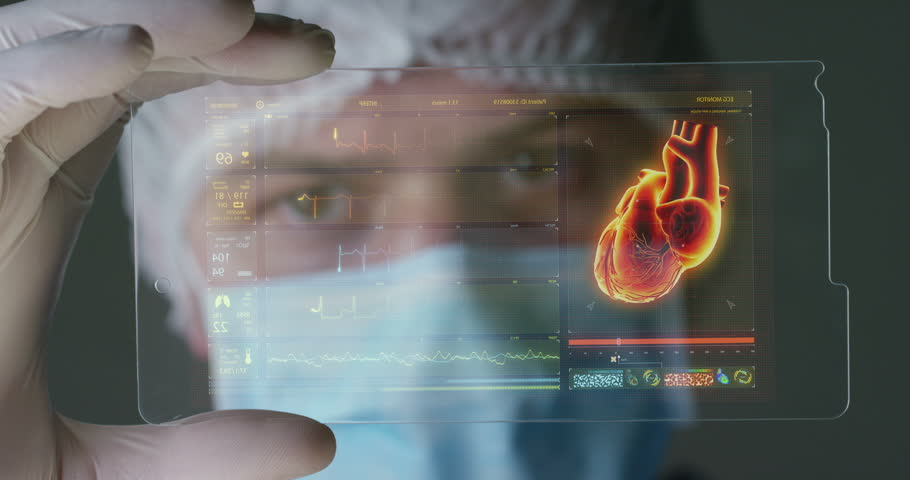 A futuristic physician, a surgeon, examines a technological digital holographic plate, a medical mask, a cap, brown eyes. Concept: futuristic medicine, new technologies, doctors, laboratory, future. | Shutterstock HD Video #27340198