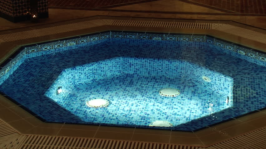 DUBAI, UAE - CIRCA 2008: Pan-right shot of the pool in the Al Asalla spa and Moroccan Hammam located at the Dubai Ladies Club. The spa is lavishly decorated with Moroccan design motifs.