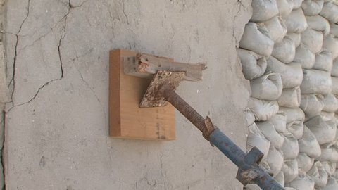 SHARJAH, UAE - CIRCA 2008: Tilt-down shot on a support column holding up a wall with sand bags in the partially reconstructed historical area, part of the cultural revival of Sharjah.