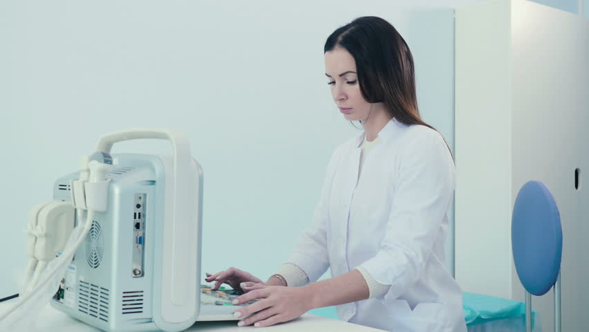 A woman works with an ultrasound device in clinic | Shutterstock HD Video #27368818