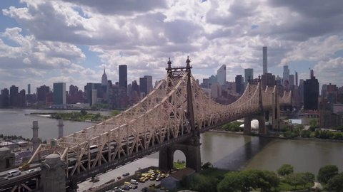 flying alongside Queensboro Bridge towards Manhattan