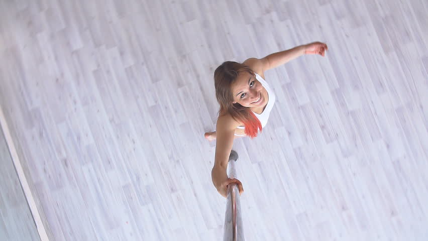 Woman exercise pole dance. Top view. hot sexy girl dancing. Slow motion
