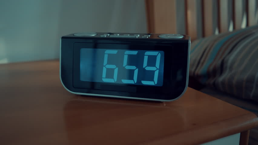 Close up shot of alarm clock turns 7 AM | Shutterstock HD Video #27396478