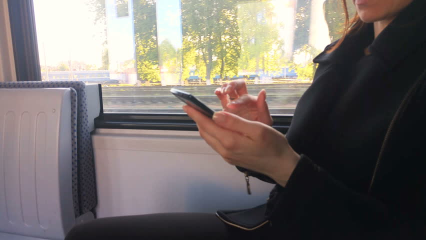 Woman with mobile phone in the train | Shutterstock HD Video #27400888