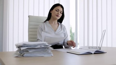 Woman have back pain after sitting all day in office