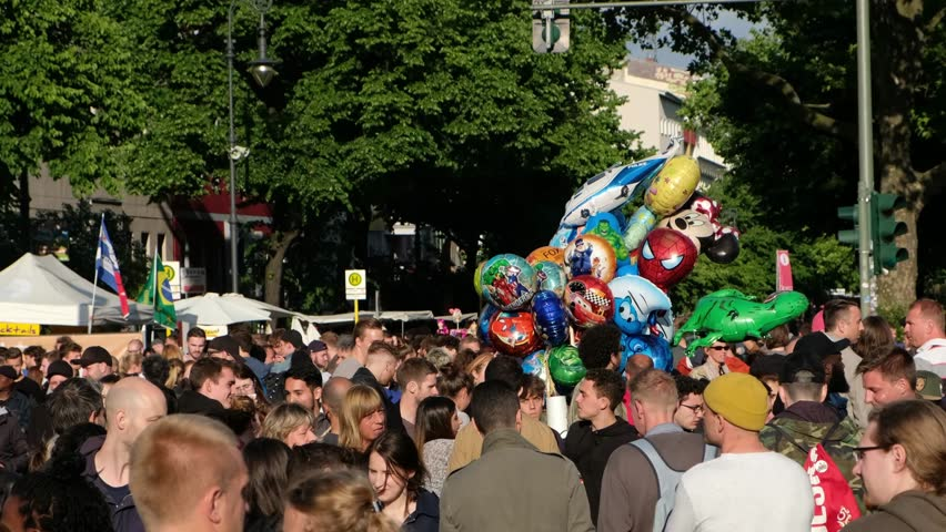 Berlin, Germany - june 04, 2017:   Crowded Street scene with many people and police on Karneval der Kulturen ( Carnival of  Cultures) in Berlin, Kreuzberg