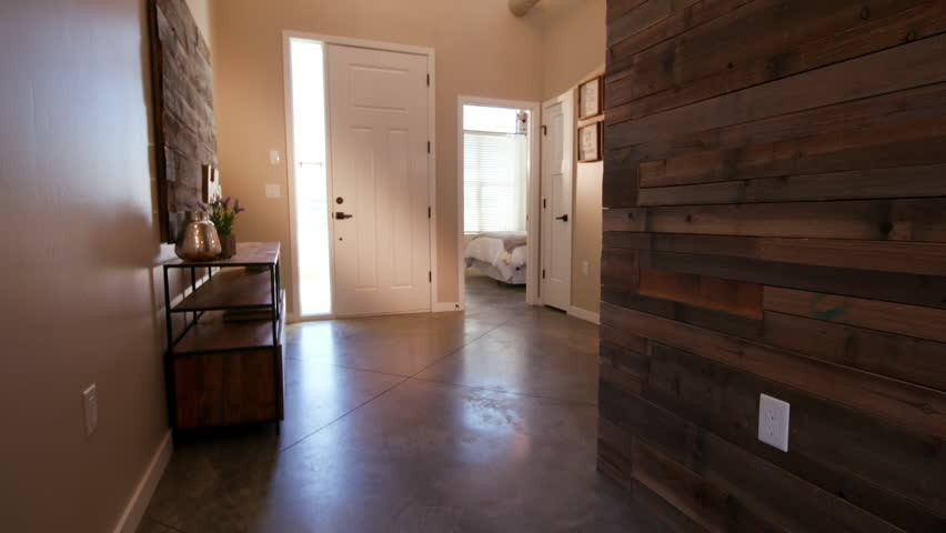Rising Home Entrance Hallway with Wood Wall. view looking at the front door of a home entrance way and hallway