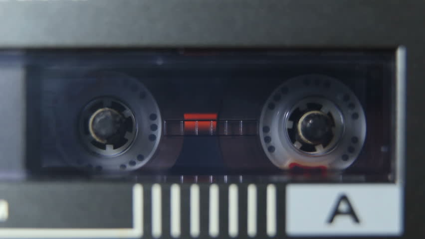 Rotating Reels of Cassette in Player