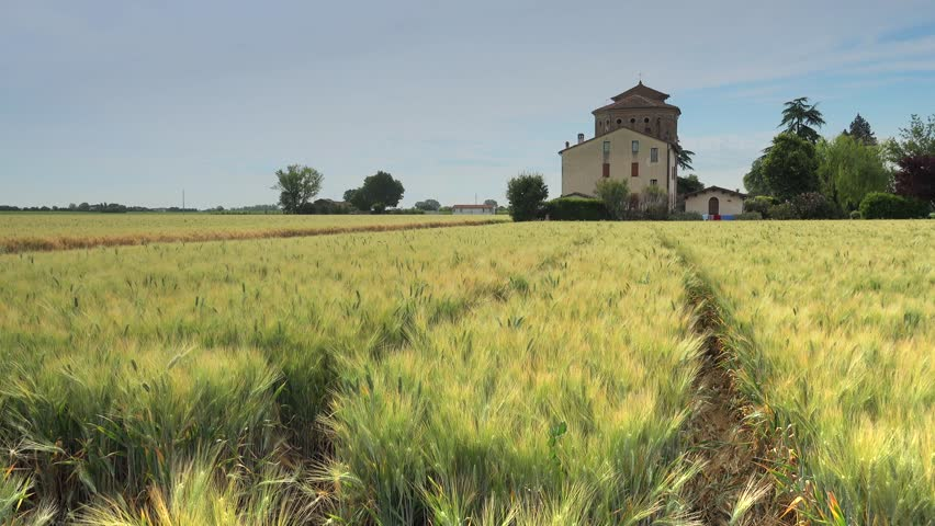 timelapse of Catholic Church on wheat fields under cloudy sky in Italy #27544702