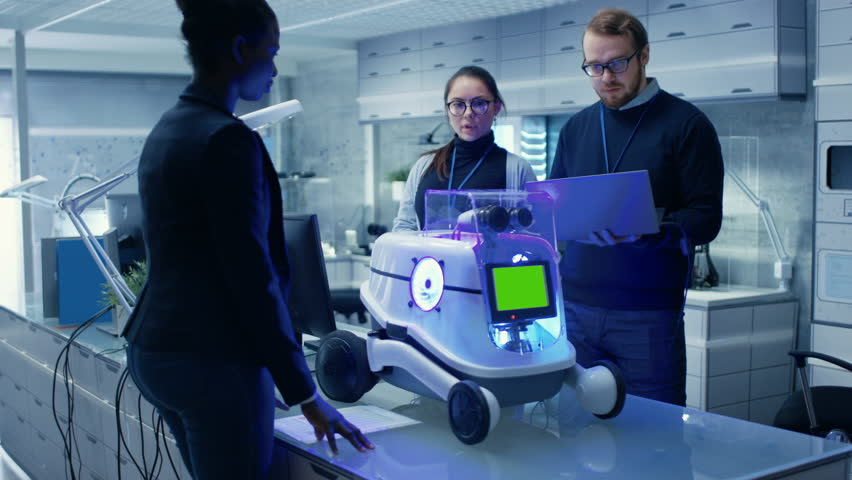 International Team of Male and Female Leading Scientists Work on Innovative Robotics Technology. Robot Has Green Mock-up Screen. They Work in a Modern Laboratory/ Research Center. RED EPIC 4K UHD | Shutterstock HD Video #27552226