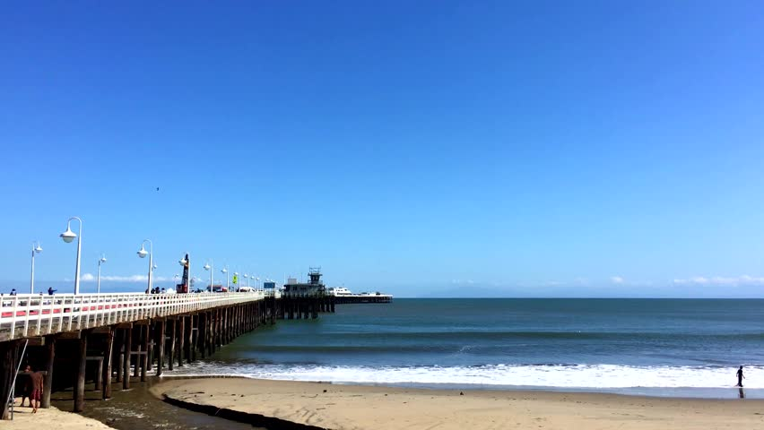 SANTA CRUZ, CA, USA - 30 APRIL 2017: Santa Cruz Wharf at Covells Beach, Santa Cruz, California in 2017. With a length of 2,745 feet (836.68 m), it is the longest pier on the West Coast of the US.