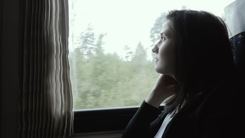 Attractive Woman In Thought Looking Out of a Train Window, Slow Motion, Travel Concept | Shutterstock HD Video #27569488