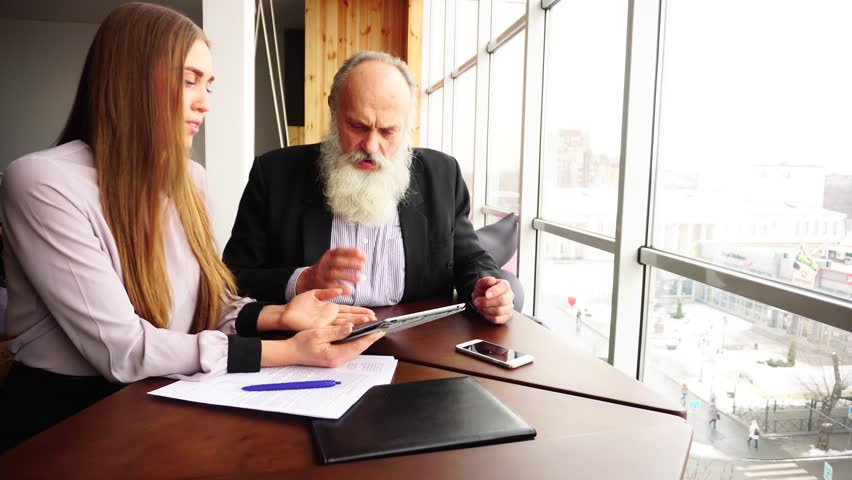 Businessmen Experienced Retired Smiling Press Tablet Touchscreen With New Young Inexperienced Employee of Large Company and Shares Valuable Tips. Beautiful Stately Grey Head Man With Long Beard and | Shutterstock HD Video #27630358