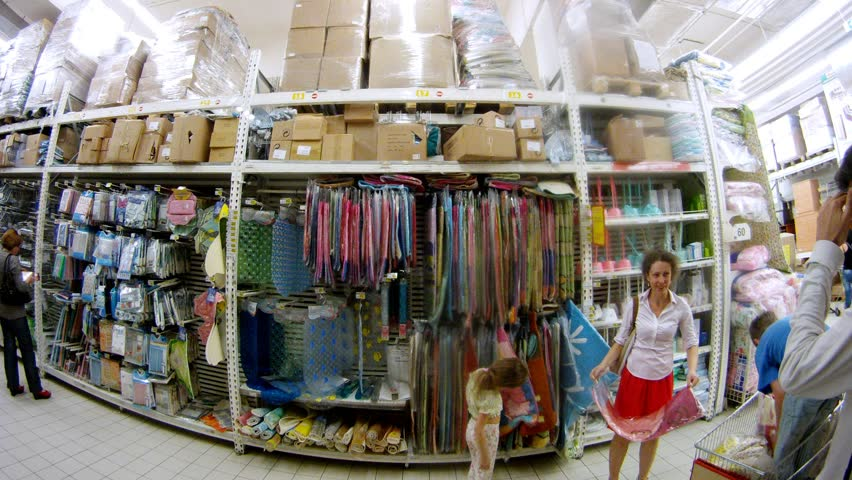 MOSCOW - JUN 15: (Timelapse View) Woman with children buys household goods in Ashan hypermarket, on Jun 15, 2012 in Moscow, Russia. Auchan chain plans to launch its first Auchan Drive outlet in Moscow next year.