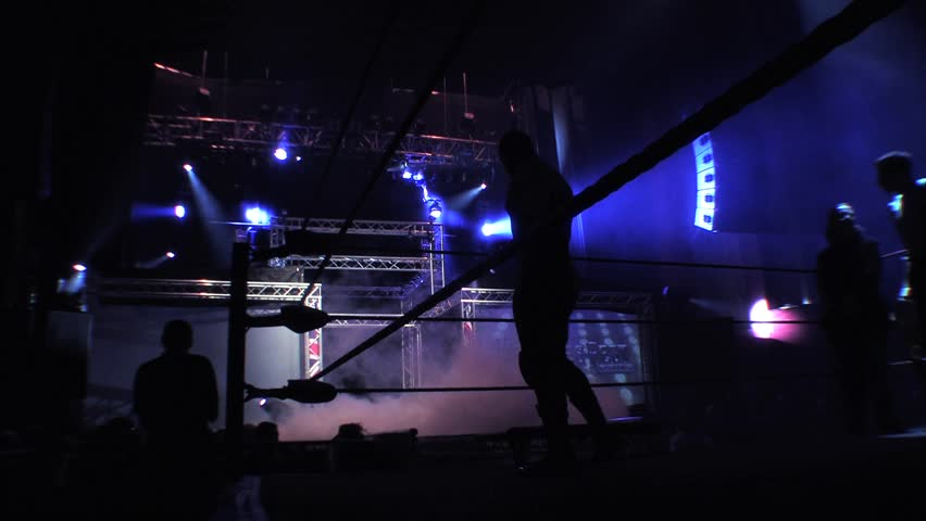 LONDON - APRIL 1 Pro Wrestler in Ring Silhouette with Smoke and Lighting during BritWres & Lighting Engineer Working Sound - Cheering Crowd HD Stock ... azcodes.com