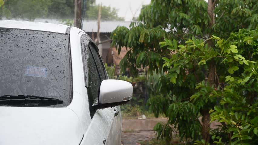 Raining on a car | Shutterstock HD Video #27668218
