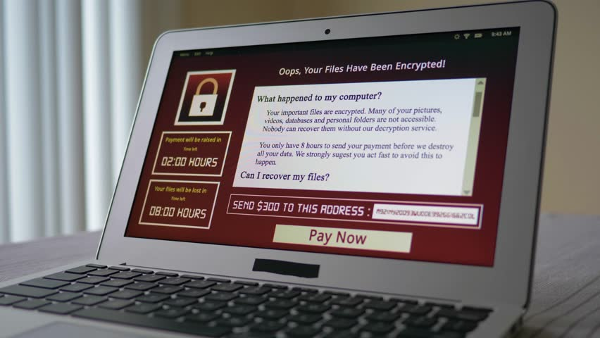 Laptop computer being infected by a ransomware virus that is asking for money to retrieve the encrypted files.