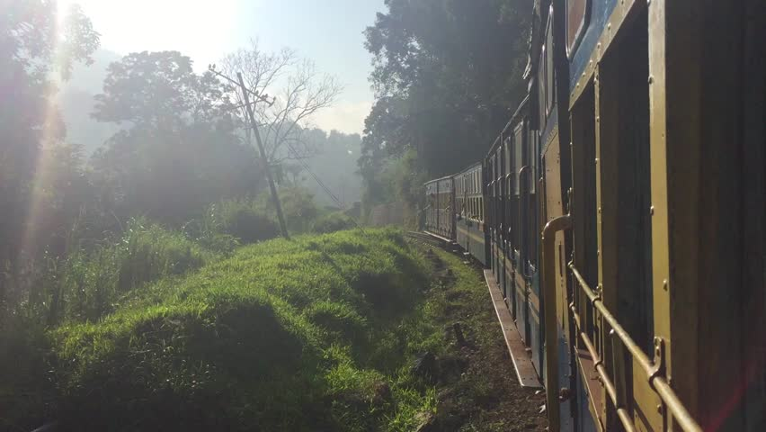 Scenic landscapes passing behind train window. India. HD.