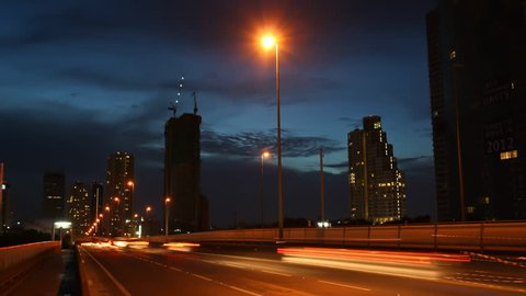 Light on road in evening, Bangkok, Thailand