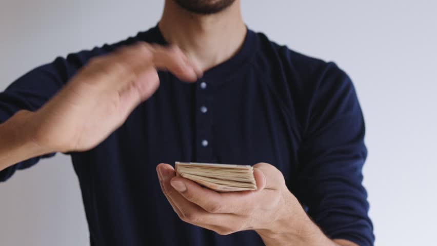 Slow motion of male hands of thin urban modern businessman in casual outfit making it rain after successful business deal in startup company   Shutterstock HD Video #27685858