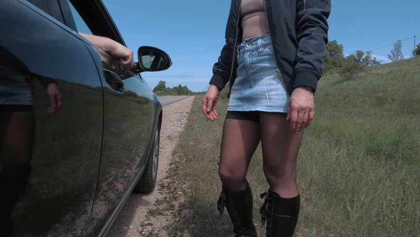 Prostitute talking with client near car | Shutterstock HD Video #27720298