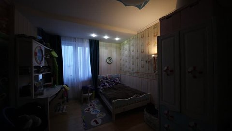 Turning on and off light in room with marine furniture for boy