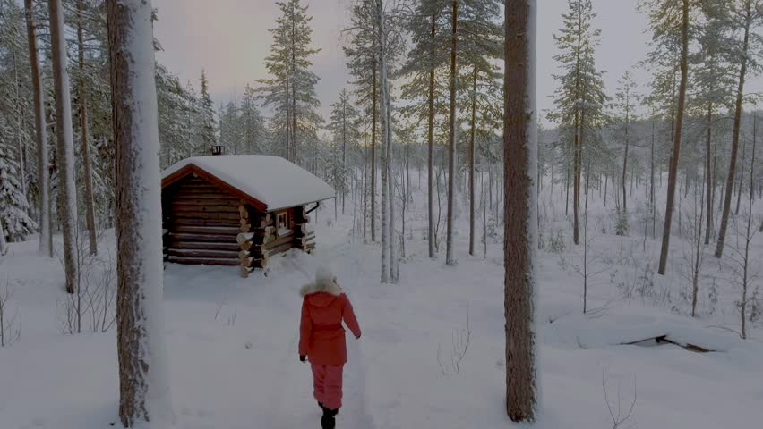 Woman tourist and sauna house in the beautiful Lapland landscape