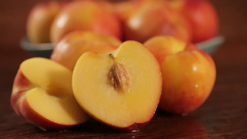 Sweet fresh nectarine dolly-shot in natural light on old wood | Shutterstock HD Video #27766297