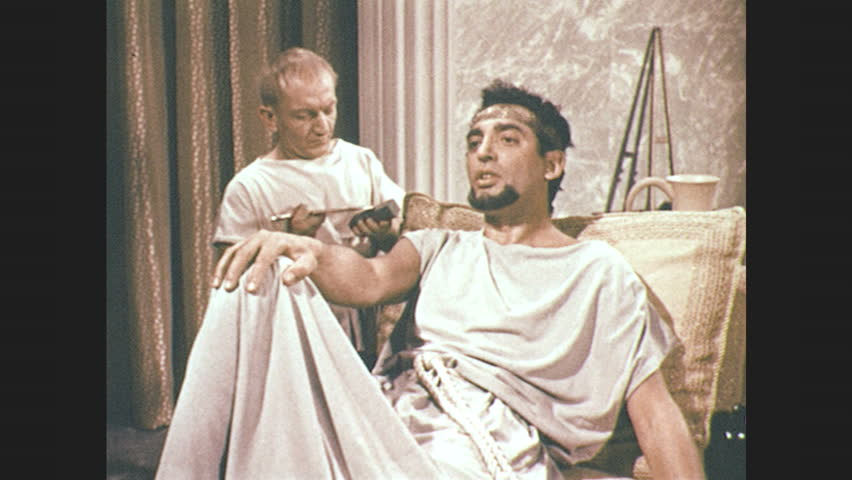 1960s: little man sharpens his razor on a stone. man in toga sits on recliner and counts to five on his fingers.