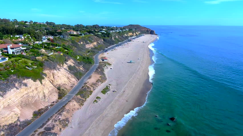 Aerial drone 4K views of beautiful Point Dume, Malibu Beach, California. Surreal drone aerials of waves, sand, and sunshine in sharp 4K. Excellent for b-roll clips, titles, commercials, websites...