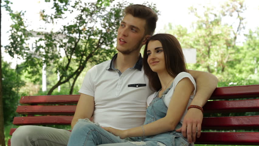 handsome guy with a girl hugging and talking outdoors #27836728