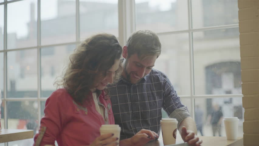 Couple using digital tablet together in coffee shop   Shutterstock HD Video #27867409