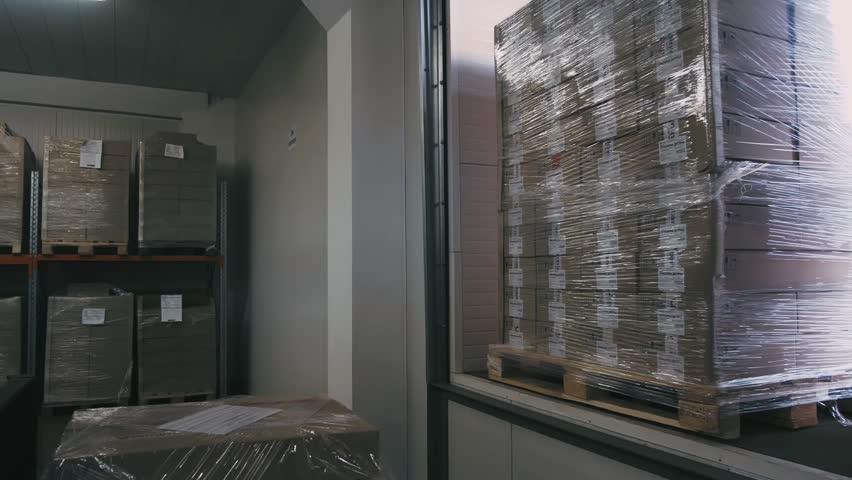 Warehouse worker with a yellow hand pallet truck   Shutterstock HD Video #27874108