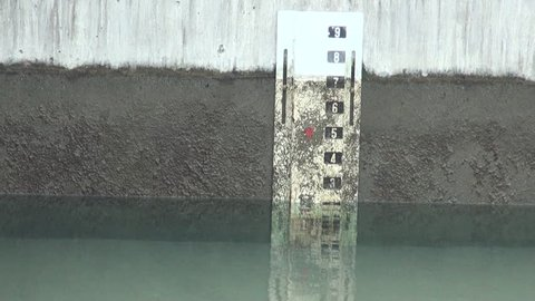 Pool or water tank is draining, the water level is going down. Water treatment plant located in Taipei, northern Taiwan.