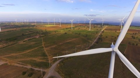 Wind turbine farm from aerial view by drone. Renewable energy, sustainable development, environment friendly concept.