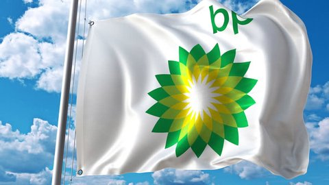 Waving flag with BP logo against moving clouds. 4K editorial animation