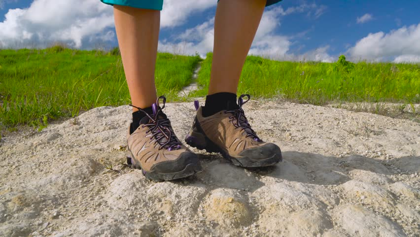 Legs of woman in tourist boots close-up. Hiking | Shutterstock HD Video #27908758