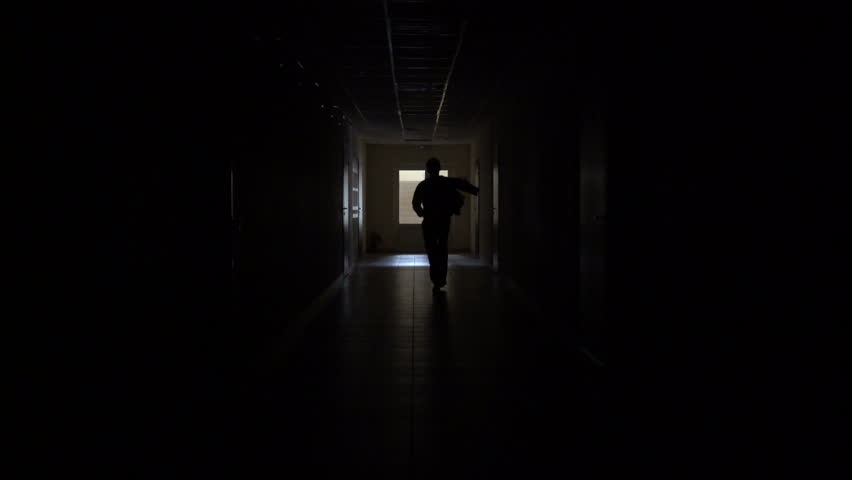 Slow motion. Silhouette of a man runs through the dark corridor. Dismissal.The Ghost of a businessman .The path to success. | Shutterstock HD Video #27920248