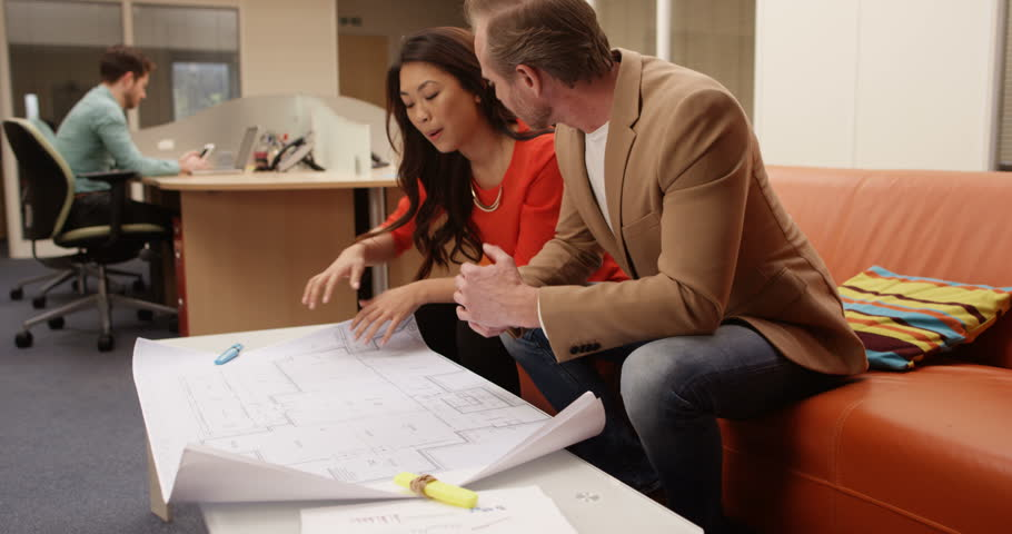 4K Architects or designers in a meeting, discussing floor plans for new development. Slow motion. | Shutterstock HD Video #27925918