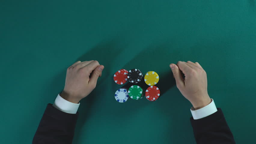 Businessman betting all-in in poker game, risky decision, cunning and bluff | Shutterstock HD Video #27934258