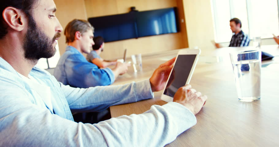 Executives using digital tablet in conference room of office | Shutterstock HD Video #27938458