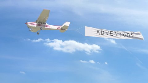 Small propeller airplane towing banner with ADVENTURE caption in the sky. 4K clip