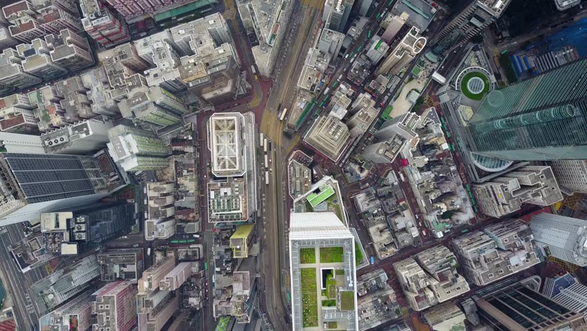 Fly high above Hennessy Road from Hysan Place to Yee Wo Street, top-down perspective aerial shot of urban Hong Kong Island area. Small traffic at morning hours, dense developed Causeway Bay district