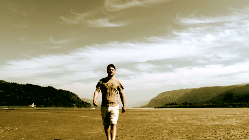 man walking towards camera in the Columbia River Gorge separating Washington and Oregon.